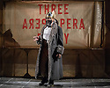 London, UK. 25.05.2016. THE THREEPENNY OPERA by Bertolt Brecht and Kurt Weill in a new adaptation by Simon Stephens, directed by Rufus Norris, opens in the Olivier Theatre on 26 May as part of the £15 Travelex season. Lighting design is by Paule Constable with set and costume design by Vicki Mortimer. Picture shows: George Ikediashi (Balladeer). Photograph © Jane Hobson.