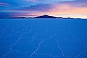 Salar de Uyuni at sunrise; largest salt pan on earth; Altiplano, Bolivia