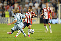 Chance Myers (7) sporting KC defender challenges Marco Fabian (8) Chivas Guadalajara midfieder... Sporting Kansas City played Chivas Guadalajara to a 2-2 tie at LIVESTRONG Sporting Park, Kansas City, Kansas in an international friendly.