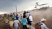 Spectators at a local race meeting in Dodge CIty, Kansas. Horse racing is a favourite past time of many of the Hispanic migrant workers who have come to the area to work in its meat packing plants. .