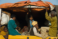 Participants of Janadesh 2007 go home in the back of a yellow truck, Ram Lila Mela Grounds, New Delhi, October 29th 2007