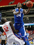 DeAndre Liggins takes a shot against Vernon Macklin during the championship of the 2011 SEC Tournament between, at the Georgia Dome, Sunday, March 13, 2011.  Kentucky beat Florida 70-54. Photo by Latara Appleby | Staff