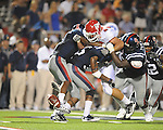 Fresno State's Chris Carter (43)  fumbles after being hit by Ole Miss safety Fon Ingram (35) and Ole Miss defensive tackle Jerrell Powe (57) at Vaught-Hemingway Stadium in Oxford, Miss. on Saturday, September 25, 2010. The ball was recovered by Ole Miss cornerback Charles Sawyer (3). Ole Miss won 55-38.