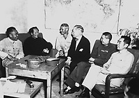 Conference at Yenan Communist Headquarters before Mao Tze Tung, chairman, left for Chungking meeting.  Central figures are U.S. Ambassador Patrick J. Hurley, Col. I.V. Yeaton, U.S. Army Observer, and Mao Tze Tung.  August 27, 1945.  T5c. Frayne.  (Army)<br /> NARA FILE #:  111-SC-360599<br /> WAR &amp; CONFLICT BOOK #:  1152