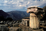 Greek ruins on hill top in Delphi with valley below in the distance in Greece.