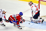 10 February 2010: Washington Capitals' goaltender Jose Theodore makes a save against right wing forward Brian Gionta of the Montreal Canadiens at the Bell Centre in Montreal, Quebec, Canada. The Canadiens defeated the Capitals 6-5 in sudden death overtime, ending Washington's team-record winning streak at 14 games. Mandatory Credit: Ed Wolfstein Photo
