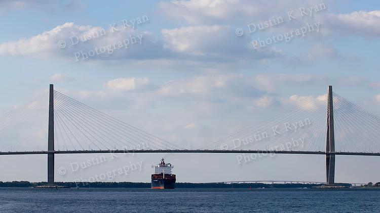 Container Ship St Louis Express sailing under the Arthur Ravenel Jr bridge on the cooper river chaleston SC