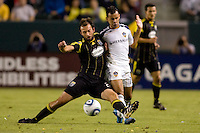 Columbus Crew midfielder Adam Moffat beats LA Galaxy midfielder Juninho to the ball. The LA Galaxy defeated the Columbus Crew 3-1 at Home Depot Center stadium in Carson, California on Saturday Sept 11, 2010.