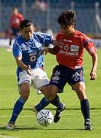 Cruz Azul midfielder Rogelio Chavez (L) fights for the ball with Veracruz Tiburones Rojos midfielder Omar Rivera during their soccer match in the Azul Stadium in Mexico City, April 8, 2006. Cruz Azul won 3-0 to Veracruz. .. Photo by © Javier Rodriguez