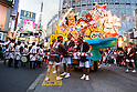 """Sept. 17, 2011 - Tokyo, Japan - An illuminated nebuta is carried through Shibuya's main shopping alley in downtown Tokyo. The term """"Nebuta"""" is a float of a heroic warrior figure that is carried by dancers dressed in traditional Japanese costumes. Every year, these floats originally from Aomori Prefecture, have been invited to be showcased in Tokyo. (Photo by Christopher Jue/AFLO)"""