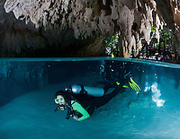 RX0354-D. scuba diver (model released) begins a cenote dive, having entered the water through a hole in the jungle floor. This underground chamber leads to passageways and rooms spectacularly decorated with limestone formations. Riviera Maya, Yucatan Peninsula, Mexico.<br /> Photo Copyright &copy; Brandon Cole. All rights reserved worldwide.  www.brandoncole.com