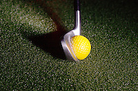 A golf club moving at 97 miles per hour (43.36 m/s) hits a stationary golf ball.  The action is recorded by a fast strobe with a duration of 1/1,000,000th of a second.  In all collisions momentum is conserved.   This ball is a soft driving ball - not a regulation play ball..