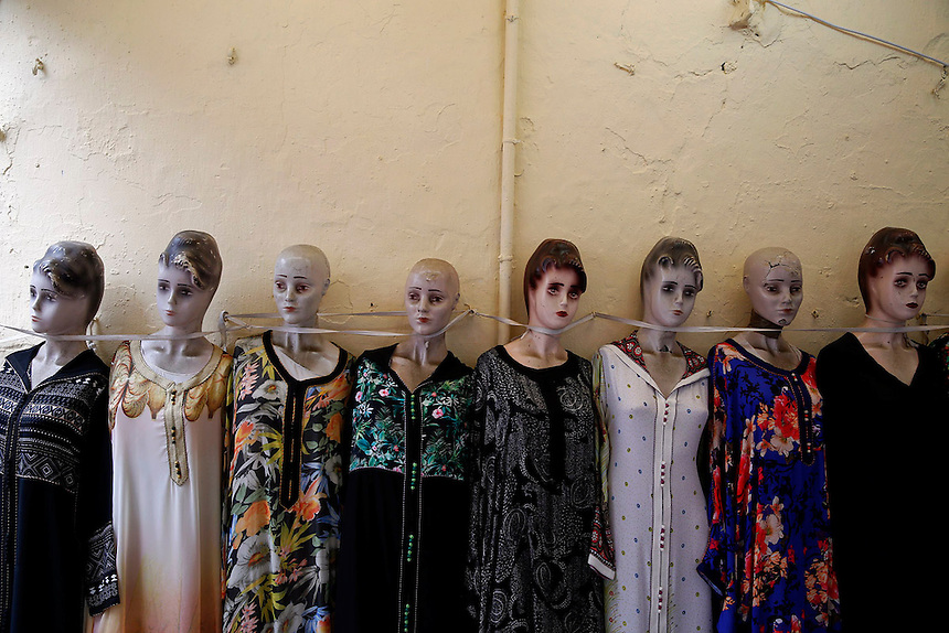 """Mannequins with ladies clothes for sale are lined against the wall in Rabat's Medina September 21, 2014. Behind walls of Medina and Kasbah of the Oudayas, ancient neighbourhoods of Morocco's capital, labyrinths of small alleys, colourful buildings and street markets offer a glimpse into city's rich history. Rabat was recently listed by UNESCO as a World Heritage Site and suggested as a """"must see"""" destination by major media outlets and tourist agencies.  REUTERS/Damir Sagolj (MOROCCO)"""