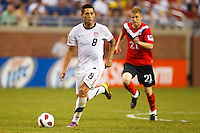 7 June 2011: USA Men's National Team forward Clint Dempsey (8) dribbles the ball by Canada midfielder Jonathan Beaulieu-Bourgault (21) during the CONCACAF soccer match between USA MNT and Canada MNT at Ford Field Detroit, Michigan. USA won 2-0.