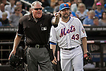 New York Mets Pitcher R.A. Dickey and HP umpire Tim Welke react during their game against Miami Marlins at Citi Field Stadium in New York. Photo by Eduardo Munoz Alvarez / VIEW.