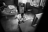 Wroclaw 02.02.2007 Poland.<br /> Eryk Wozniak, 4.5 in his room playing on computer.<br /> Clinical Hospital, oncology and haematology departmend. This is one of the important Haematologic Hospital in all over Poland, however hospital board stopped to discharge a rising debt. In this connection authorities must close hospital, but goverment had no idea what should do with terminaly ill children.<br /> (Photo: Adam Lach / Napo Images)<br /> <br /> Eryk Wozniak ( 4.5 lata ) w swojej sali na oddziale pooperacyjnym.<br /> Akedemicki Szpital Kliniczny, oddzial onkologii i hematologii. Temu jednemu z najwazniejszych w Polsce osrodkowi szpitalnemu grozi zamkniecie w powodu dlugow, ktore niezaleznie od wplat NFZ-tu regularnie sciaga komornik. Z calej Polski ludzie charytatywnie wplacaja pieniadze by uratowac szpital i los dzieci dla ktorych to miejsce jest jedynym ratunkiem.