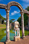 Statues and columns that surround a rectangular basin that ends at The Serapaeum, dedicated to the gods Isis and Serpis which was probably used as a banqueting hall. Hadrian's Villa ( Villa Adriana ) built during the second and third decades of the 2nd century AD, Tivoli, Italy. A UNESCO World Heritage Site.