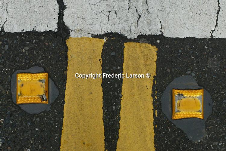 Median double yellow line on California Street in San Francisco, California.