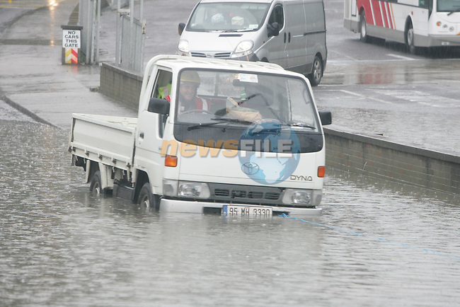 Mambers of the Drogheda Fire Service assist the driver of this vehicle stuck in the flash floods at the bottom of the Donore road in Drogheda.Photo:Fran Caffrey/www.newsfile.ie.(Photo credit should read Fran Caffrey/NEWSFILE).