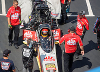 Sep 17, 2016; Concord, NC, USA; NHRA top fuel driver Doug Kalitta with crew members  during qualifying for the Carolina Nationals at zMax Dragway. Mandatory Credit: Mark J. Rebilas-USA TODAY Sports