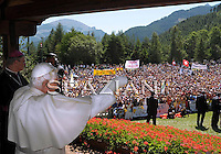 Pope Benedict XVI  wearing a cast on his right arm, Pope Benedict XVI after breaking his wrist greets arrives to celebrate the Angelus prayer in Les Combes d'Introd, near Aosta, northern Italy, Sunday, July 26, 2009. The pontiff is spending his vacation in Les Combes, in the Aosta Valley region, until July 29,
