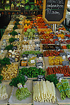 Fresh salad vegetables on market stall in vegetable market. Viktualienmarkt, Munich, Germany.