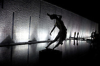 "People walk past sculptures outside the Memorial Hall of the Nanjing Massacre in Nanjing, China, on Thursday, Dec. 13, 2007.  After two years of renovations, the Memorial Hall of the Nanjing Massacre reopened to the public on Dec. 13, 2007, the 70th anniversary of the 6-week massacre by Japanese troops that started Dec. 13, 1937 and claimed more than 300,000 lives.  The commemoration comes amid renewed controversy about the accuracy of historical accounts of the massacre.  The massacre is also known as ""The Rape of Nanking."""