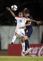 Shirley Cruz of Costa Rica (left) goes up for the header against Amy LePeilbet (right).. USWNT defeated Costa Rica 4-0 in the 2010 CONCACAF Women's World Cup Qualifying tournament held at Estadio Quintana Roo in Cancun, Mexico on November 1st, 2010.