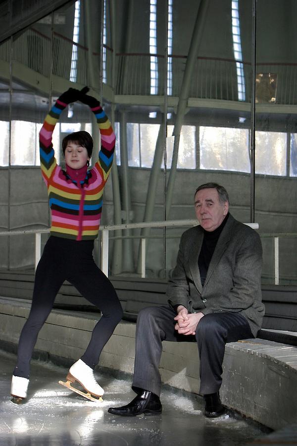 Moscow, Russia, 20/02/2004..Chief coach Vladimir Sadikov and world champion skater Irina Slutskaya in the training hall at the SUP [Trade Union Moscow] club..