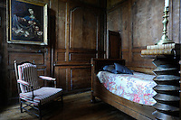 No other decoration is necessary that might detract from the beautiful mellow panelling of this bedroom