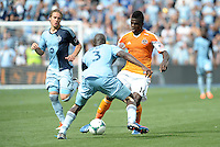 Jason Johnson (14) forward Houston Dynamo faces Ike Opara..Sporting Kansas City and Houston Dynamo played to a 1-1 tie at Sporting Park, Kansas City, Kansas.