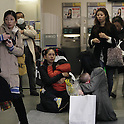 March 11, 2011, Tokyo, Japan - Mothers with their children sit on the floor of a local bank as Tokyo is shook by aftereffects of Friday's powerful earthquake that struck Japan's northern area on March 11, 2011.  The quake with a magnitude of 8.9 hit Miyagi prefecture, causing damages in northern Japan. (Photo by Akihiro Sugimoto/AFLO) [1080] -mis-