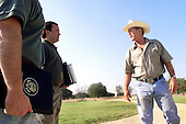 Crawford, TX - August 6, 2001 -- United States President George W. Bush talks with his senior staff at the Bush Ranch in Crawford,  Texas, Monday morning, August 6, 2001. From left, deputy chief of staff Joe Hagin and deputy press secretary Scott McClellan . .Credit: Eric Draper - The White House via CNP