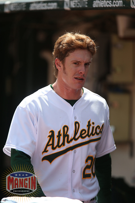 OAKLAND, CA - APRIL 9:  Mark Canha #20 of the Oakland Athletics stands in the dugout during the game against the Texas Rangers at O.co Coliseum on Thursday, April 9, 2015 in Oakland, California. Photo by Brad Mangin