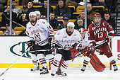 Braden Pimm (Northeastern - 14), Mike McLaughlin (Northeastern - 18), (Rawlings) Michael Del Mauro (Harvard - 13) - The Northeastern University Huskies defeated the Harvard University Crimson 4-0 in their Beanpot opener on Monday, February 7, 2011, at TD Garden in Boston, Massachusetts.