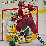 20 February 2016: University of Vermont Catamount Goaltender Packy Munson, a Freshman from Hugo, MN, get held and pushed by Boston College Eagle Forward Miles Wood, a Freshman from Manchester, MA, who subsequently received a penalty for goaltender interference during third period play against the Boston College Eagles at Gutterson Fieldhouse in Burlington, Vermont. The Eagles defeated the Catamounts 4-1 in the second game of their weekend series. Mandatory Credit: Ed Wolfstein Photo *** RAW (NEF) Image File Available ***