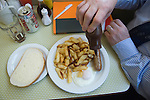 Brown sauce with  sausage egg and chips. Regency Caf&eacute;  Westminster London SW1 UK.