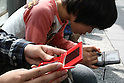 May 9, 2010 - Tokyo, Japan - Young Japanese boys play Nintendo's portable video game 'DS' in front of the official Pokemon store in Tokyo on May 9, 2010. Nintendo recently announced that the DS handheld device had become the best selling gaming handheld of all time, with a total of 129 million units sold. The DS 'family' have surpassed the &quot;Game Boy&quot; series which hit 118 million over two decades.