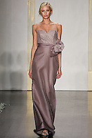 Model walks runway in a mauve mikado organza a-line gown with lace draped bodice, strapless sweetheart neckline, natural waist bridesmaid dress by Lazaro Perez, from the Noir by Lazaro Spring 2012 Bridal fashion show.
