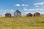 Granaries sit on the Saskatchewan Priarie near Quill Lake, Saskatchewan. After the harvest is completed the seed for the next year is stored in granaries. Largely replaced by cylindrical steel structures most wooden granaries have long since been left unused.