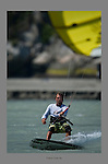 July 22nd, 2009.  Kiteboard instructor Patrick Hebb rides up the Squamish River.   On this day, high winds of 28-30 knots challenged the kiteboarders' skills.  Squamish, BC.  Photo by Gus Curtis.