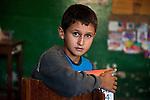 _DSC6785, Lavazza, Lambari, Brazil, 08/201, BRAZIL-10016NF2. Boy sits in his classroom with his notebook.<br /> <br /> Retouched_Ekaterina Savtsova 06/20/2014