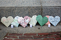 People placed flowers and paper hearts as a memorial in Boston Common in Boston, Mass., on April 16, 2013, the day after bombings at the Boston Marathon.