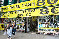 A store in Harlem in New York attempts to reduce its inventory prior to renovation by holding a sale, seen on Sunday, August 19, 2012.  (© Richard B. Levine)