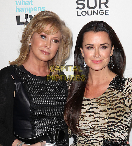 "Kathy Hilton, Kyle Richards.Bravo's Andy Cohen's Book Release Party For ""Most Talkative: Stories From The Front Lines Of Pop Held at SUR Lounge, West Hollywood, California, USA..May 14th, 2012.half length black  leather dress tiger animal print dress  beige .CAP/ADM/KB.©Kevan Brooks/AdMedia/Capital Pictures."