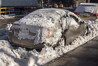 A buried vehicle in the snow in the Chelsea neighborhood of New York on Tuesday, February 3, 2015. (© Richard B. Levine)