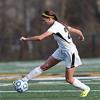 College of St Rose forward Gianna Smith (22) attempts to control the ball.. In 2012 NCAA Division II Women's Soccer Championship Tournament First Round, College of St Rose (white) defeated Wilmington University (black), 3-0, on Ronald J. Abdow Field at American International College on November 9, 2012.