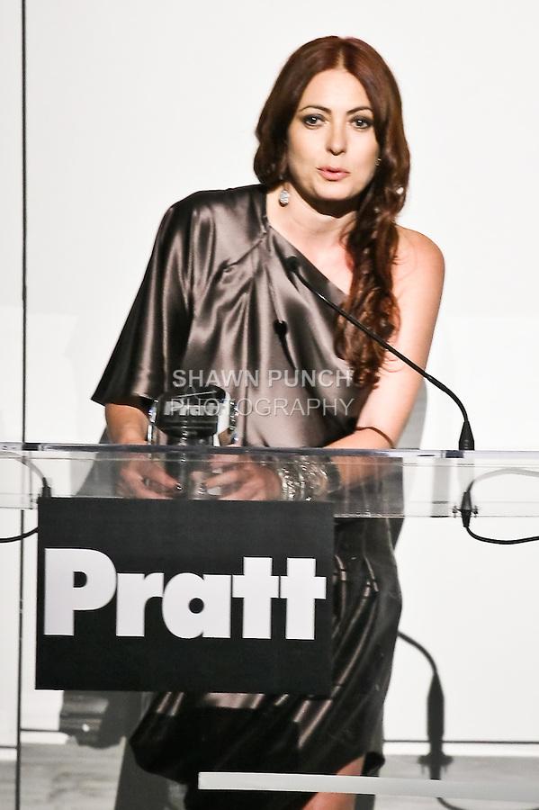 Fashion designer Catherine Malandrino makes an acceptance speech for winning the 2010 Pratt Institute Fashion Icon award, before the Pratt Institute 2010 Fashion Show on May 13, 2010.