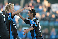 Chris Wondolowski (right) celebrates his first goal with Steven Lenhart (left). The San Jose Earthquakes tied the Vancouver Whitecaps 2-2 at Buck Shaw Stadium in Santa Clara, California on July 20th, 2011.