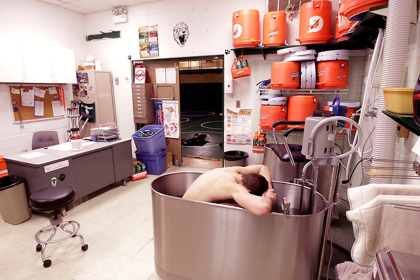 SOUTH PLAINFIELD, NJ - (March 6, 2013) -South Plainfield High School wrestler Anthony Ashnault struggles to adjust to the shocking cold as he takes an ice bath in 40-degree water after practice Wednesday evening. Ashnault is on the verge of becoming the first undefeated, 4-time state champion in the history of New Jersey.